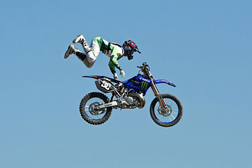 Motorcycle rider in mid-air completely off his bike