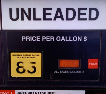 Gas pump interface showing grade sticker worn out from finger presses with smaller start button to the right