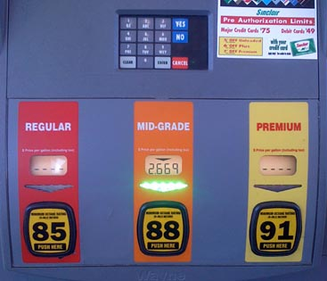 Gas pump interface showing the grade sticker that also functions as the start button